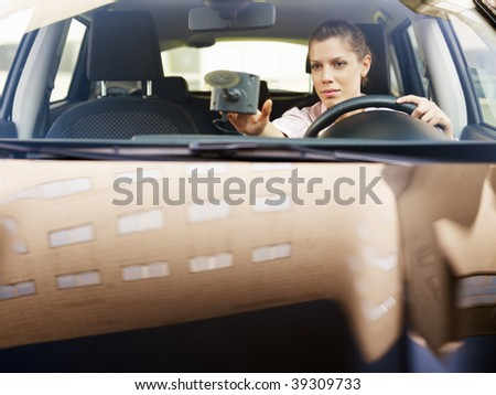 Woman typing on gps. Selective focus, copy space - stock photo