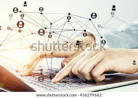 Woman typing on keyboard .  Mixed media - stock photo