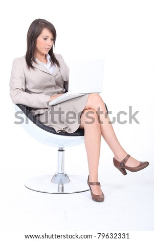 Woman typing on laptop keyboard - stock photo