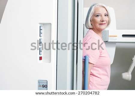 Woman undergoing medical scan. - stock photo