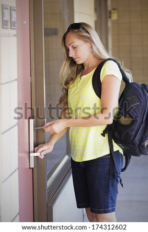 Woman unlocking her Hotel Room Door - stock photo