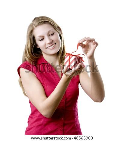 Woman unpacking present - stock photo