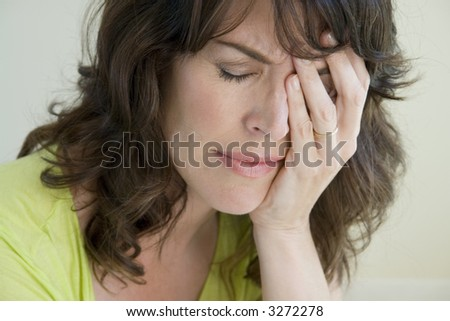Woman upset and distressed - stock photo
