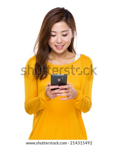Woman use of mobile phone - stock photo