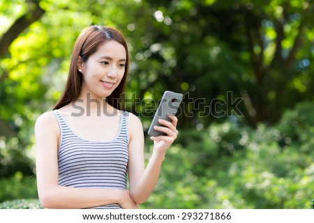 Woman use of the cellphone - stock photo