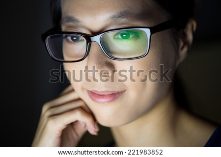 Woman use tablet overnight - stock photo