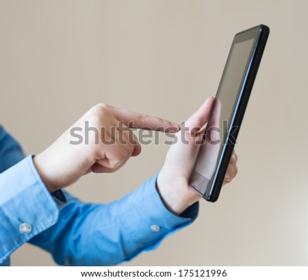 woman uses a digital tablet. Modern gadget in hand.