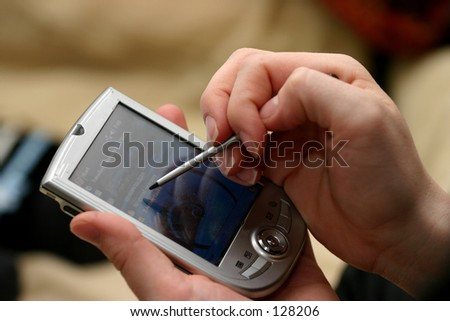 Woman using a pda - stock photo