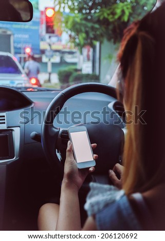 woman using a smart phone in car - stock photo