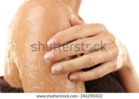 Woman using body scrub isolated on white - stock photo
