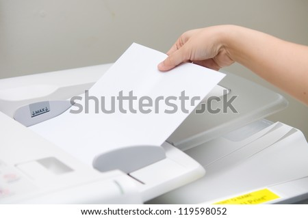 woman using copy machine