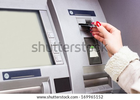 Woman using credit card to withdraw cash money  - stock photo