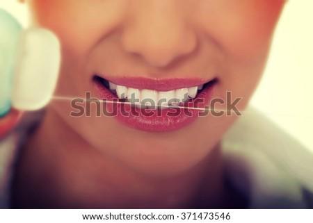 Woman using dental floss. - stock photo