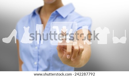 Woman using digital interface to shop online - stock photo