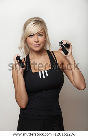woman using hand grips in her work out - stock photo