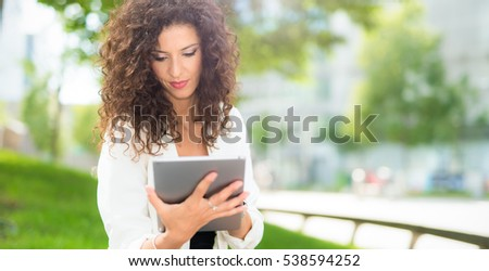 Woman using her tablet