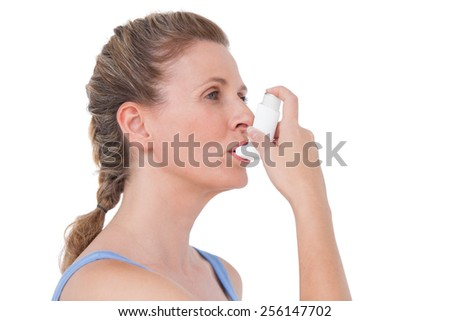 Woman using inhaler for asthma on white background - stock photo