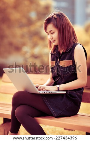 Woman using laptop indoor.close-up hand - stock photo