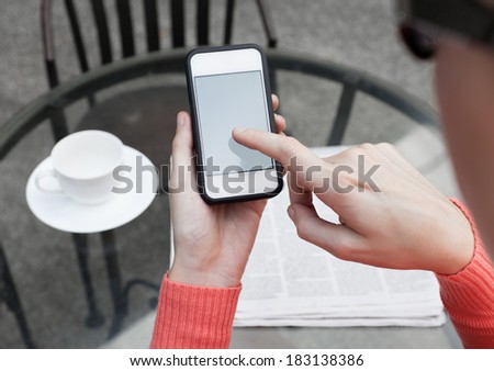 Woman using mobile smart phone in the coffee shop. - stock photo
