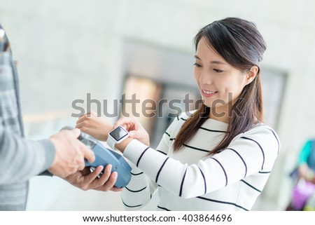 Woman using NFC payment with smart watch