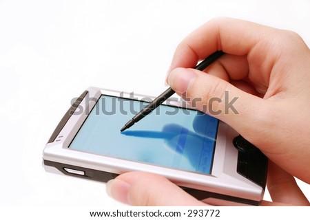 Woman using PDA - blue - stock photo