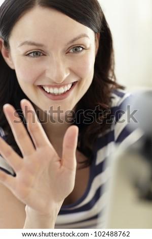 Woman using skype - stock photo