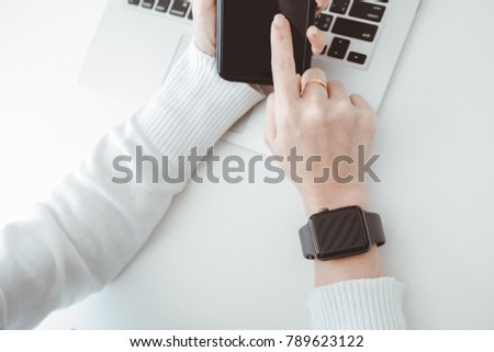 woman using smart watch in coffee shop, modern city lifestyle