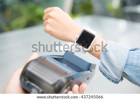 Woman using smart watch to express pay  - stock photo