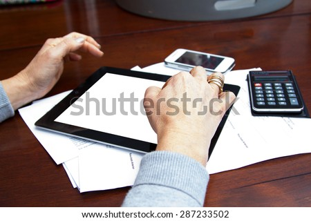 Woman Using Smartphone and Digital Tablet - stock photo