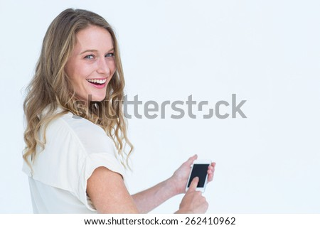 Woman using smartphone on white background