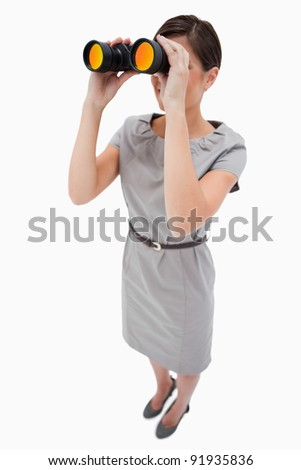 Woman using spyglasses against a white background - stock photo