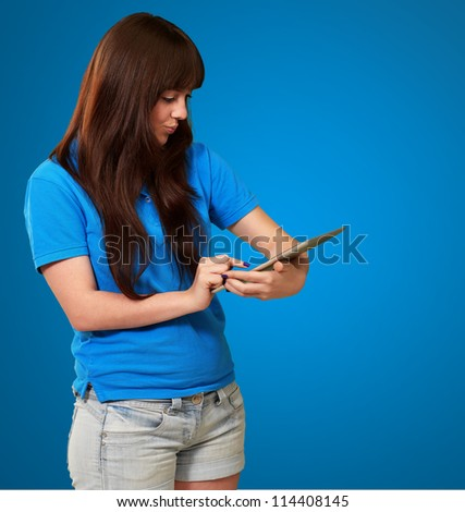 Woman Using tablet Isolated On Blue Background