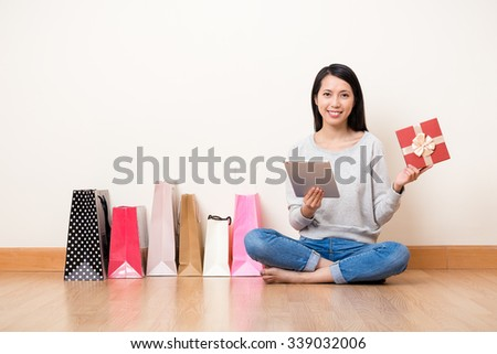 Woman using the digital tablet for online shopping - stock photo
