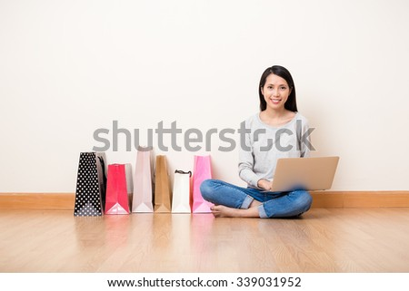 Woman using the laptop computer for online shopping - stock photo