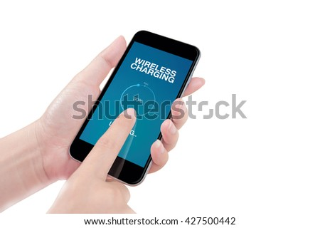 Woman using the phone with wireless charging screen on white background, isolated
