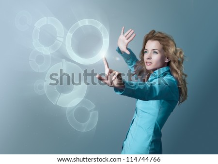 Woman Using Virtual Interface - stock photo