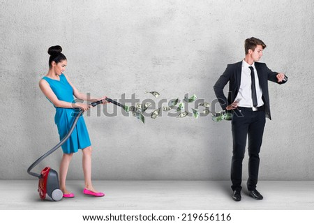Woman vacuuming money out of man's pocket - stock photo