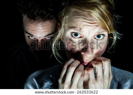 Woman Victim Afraid of her Boyfriend - Domestic Violence Concept - stock photo
