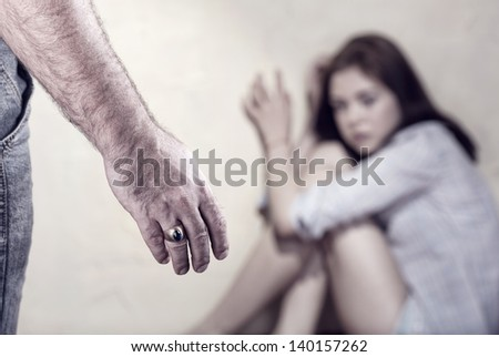 Woman victim of domestic violence and abuse. Focus on hand - stock photo