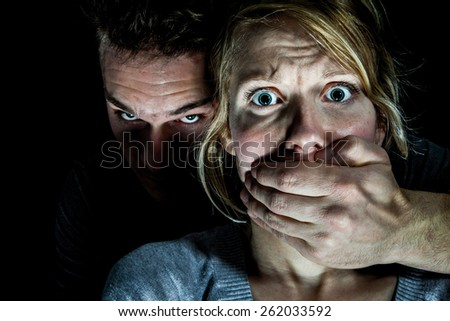 Woman Victim put to Silence by her Boyfriend - Domestic Violence Concept - stock photo