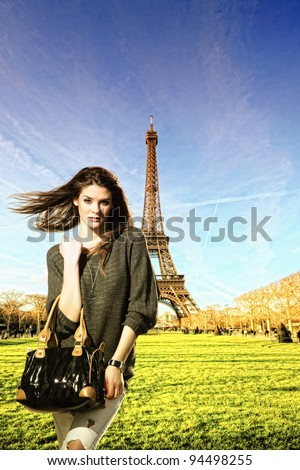 Woman visiting Paris in France with the Eiffel tower on the background - stock photo
