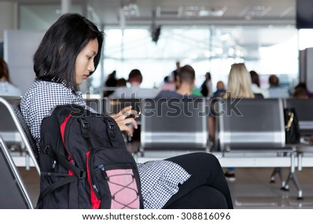 woman waiting for the plane at the airport