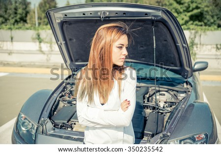 Woman waiting the assistance after car breaking down. concept about transportation - stock photo
