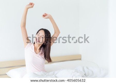 Woman waking up at morning - stock photo