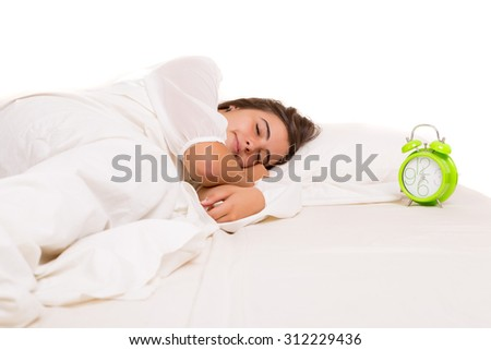 Woman waking up with the sound of the alarm clock - stock photo