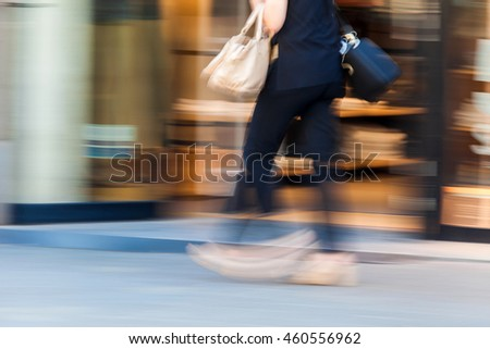 Woman walking fast with motion blur effect