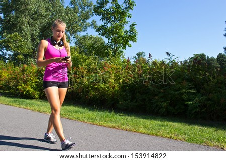 Woman walking for exercise - stock photo