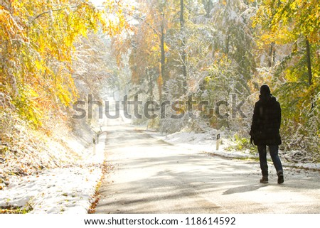 woman walking in colorful snowy forest