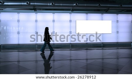 woman walking in the airport - stock photo