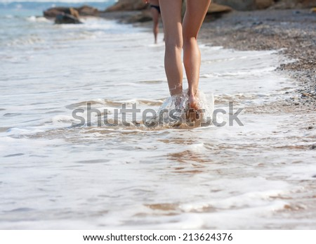 woman walking on the sand beach